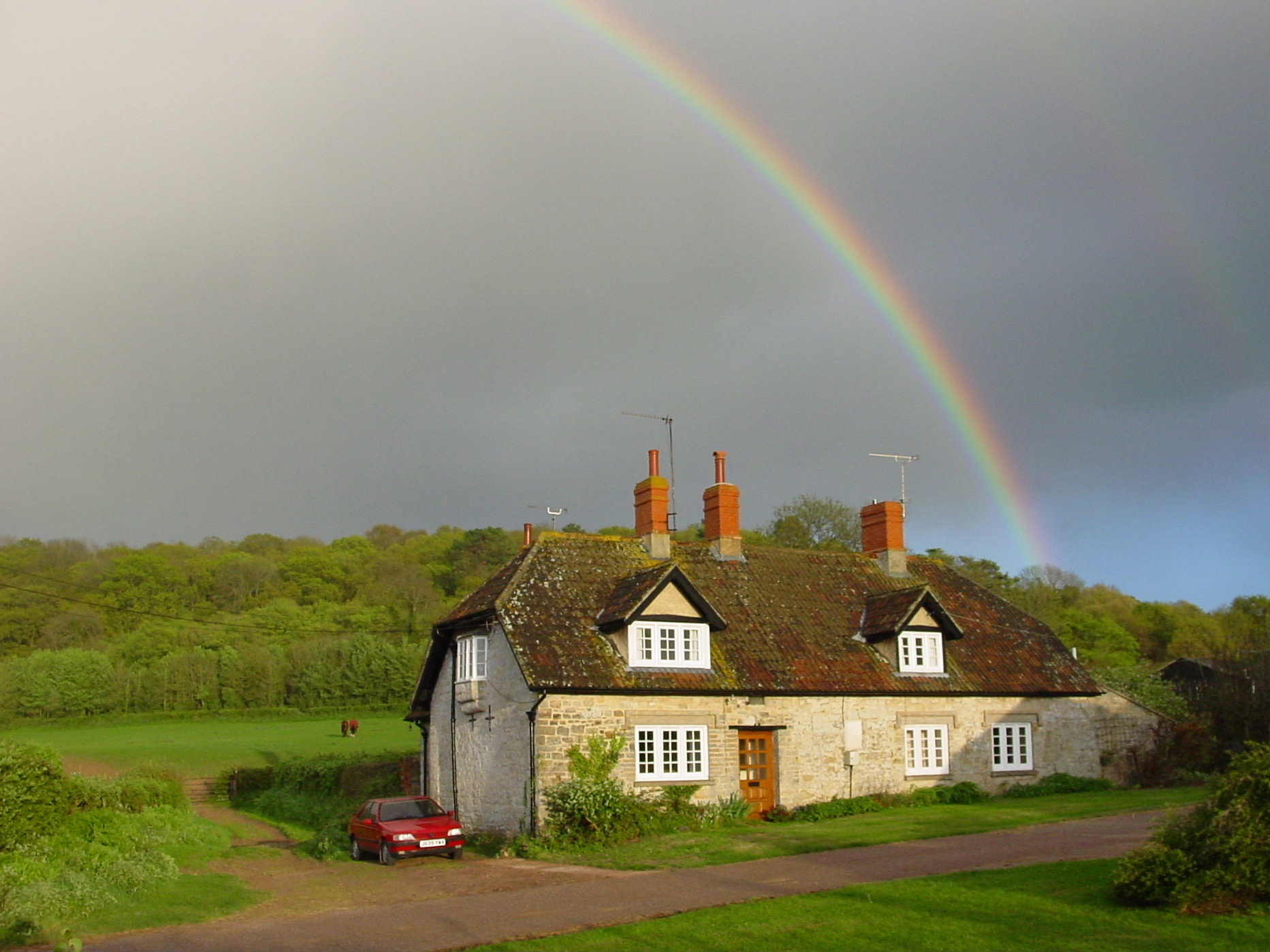 Farmhouse with rainbow
